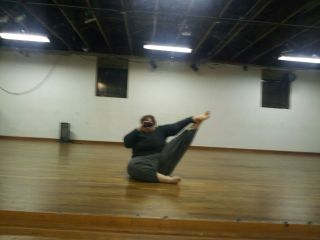 Seated heel stretch again, turned out more.